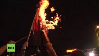 Protesters burn US flags as Obama delivers speech at DNC
