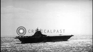USS Franklin (aircraft carrier) as she arrives at Pearl Harbor and men unloading ...HD Stock Footage