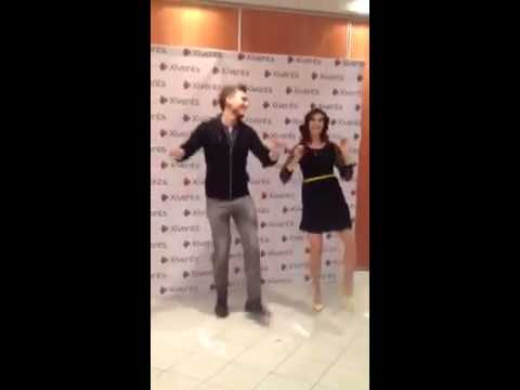 Meghan Ory and Scott Michael Foster dancing together