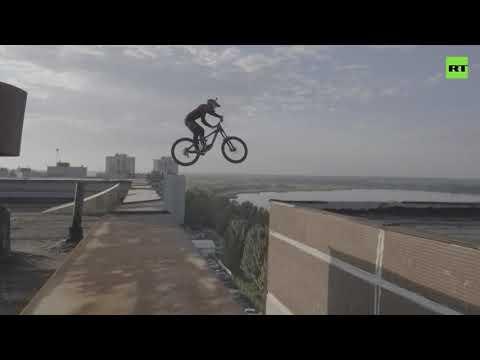 Russian man bike jumps between the rooftops of 10-storey buildings