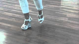 Girl taps in wedges