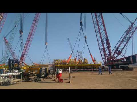 Giant cranes lifting deck