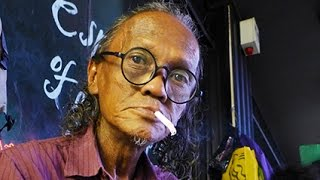 Pak Rosli : The  Street Portrait Artist Of KL