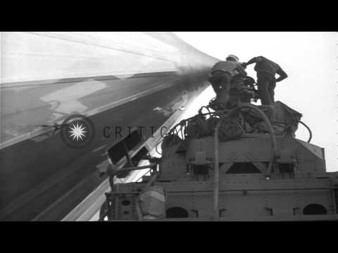 Airship LZ 129 Hindenburg lands at Lakehurst Naval Air Station in New Jersey. HD Stock Footage