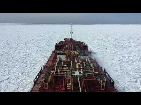 Ship moving through ice (Frozen Sea) in North Atlantic ocean