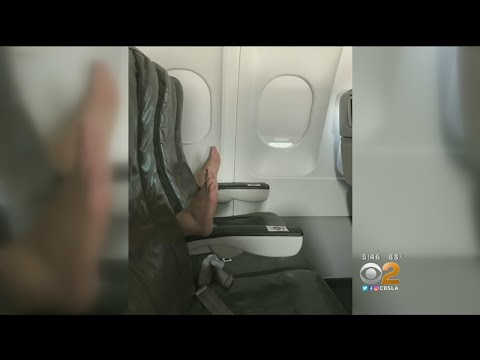 Woman's Empty Row On Plane Gets Invaded By Ugly Feet