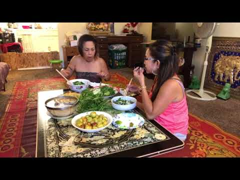 Eating traditional Lao foods with Euy Poo.