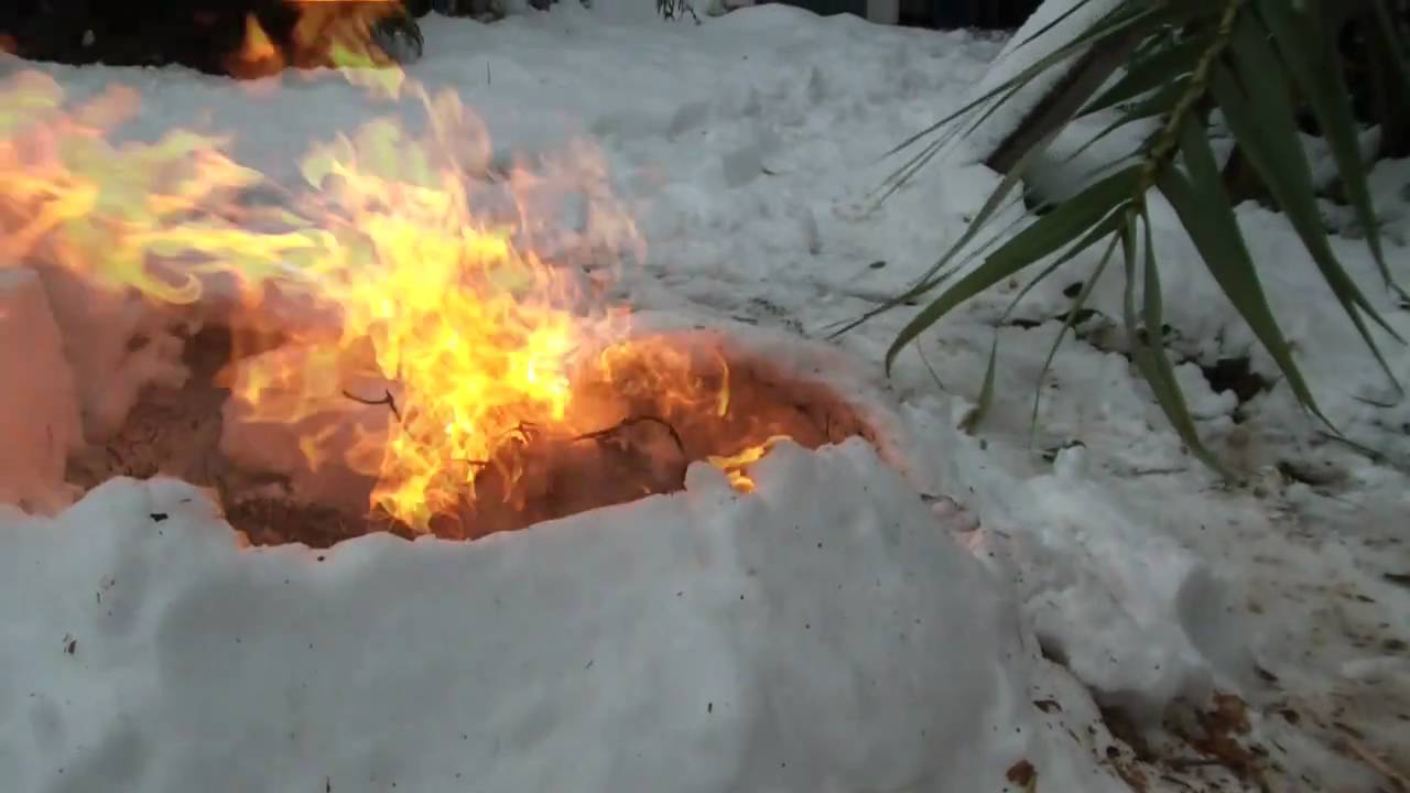 burning down a small igloo hand drill friction fire. Black Bedroom Furniture Sets. Home Design Ideas