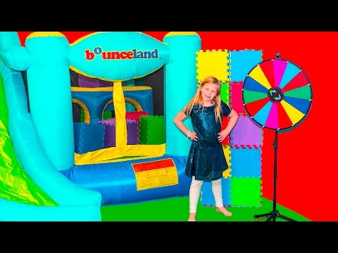 The Assistant Spins the Wheel of Color Surprise with a Bounce House
