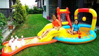 Öykü and Masal Play with Inflatable Water Slide - fun kids