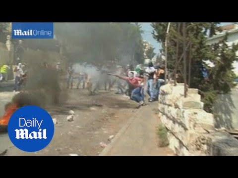 Palestinian protesters clash with Israeli police in Jerusalem - Daily Mail