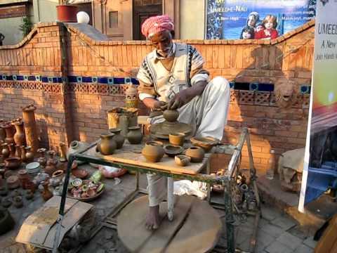 A Clay Pot Maker at work at Lok Virsa Museum, Islamabad, Pakistan
