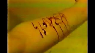Slayer fan carving logo into arm 1994