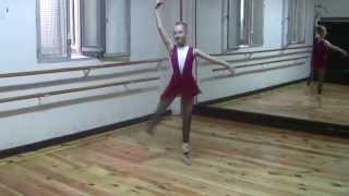 Training pointe ballet , fuettes , turns. little spanish ballerina