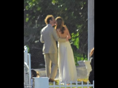 Prince Harry kisses and cuddles Meghan Markle at his close pal's wedding in Jamaica