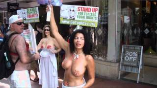 Repeat youtube video Topless protest in Miami Beach on 8/21/11