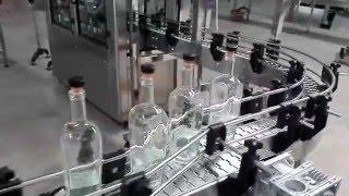 fully automatic whisky/vodka/brandy bottling line test video (rinser filler capper dryer shrinker)