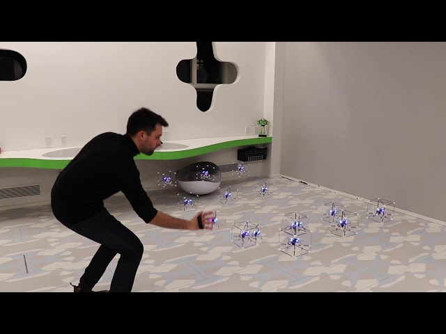GridDrones: A Self-Levitating Physical Voxel Lattice for Interactive 3D Surface Deformations