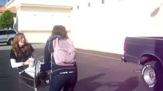 two girls one shopping cart.