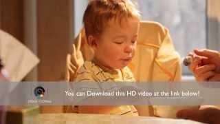 Little boy eats porridge