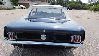 1966 Ford Mustang dark blue convertible for sale at www coyoteclassics com