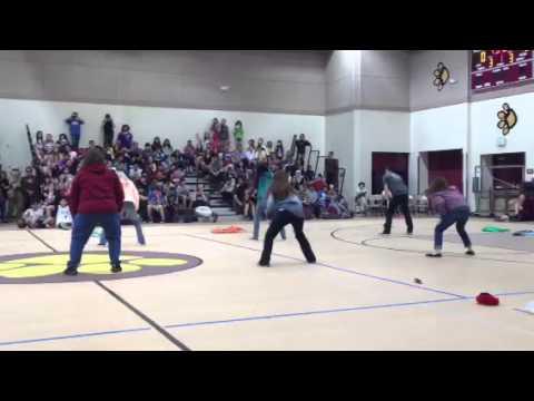 Teachers dancing at Student vs. Staff game