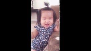 Baby playing peek-a-boo