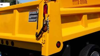 Looking at a Brand New Yellow Dump Truck