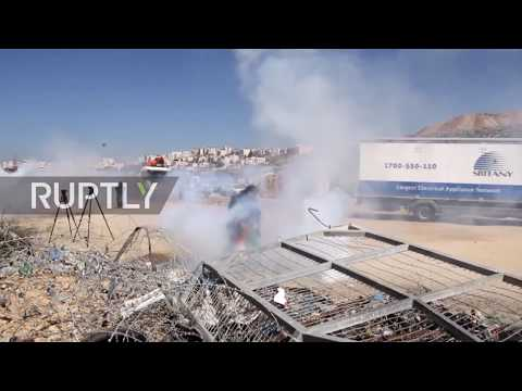 State of Palestine: Tear gas deployed as Israeli forces break protest