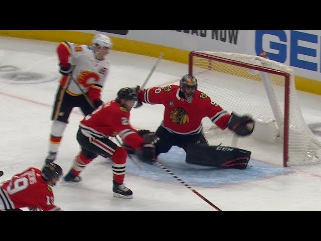 Corey Crawford extends arm for tremendous glove save