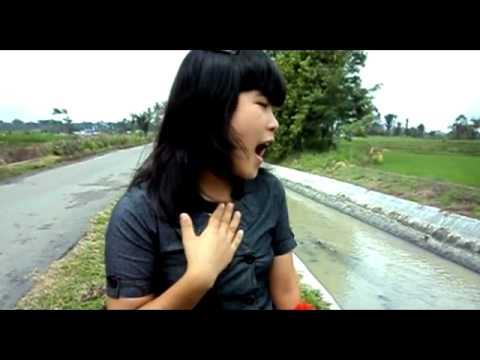 Farida Manurung Bunga NI Holong Hu