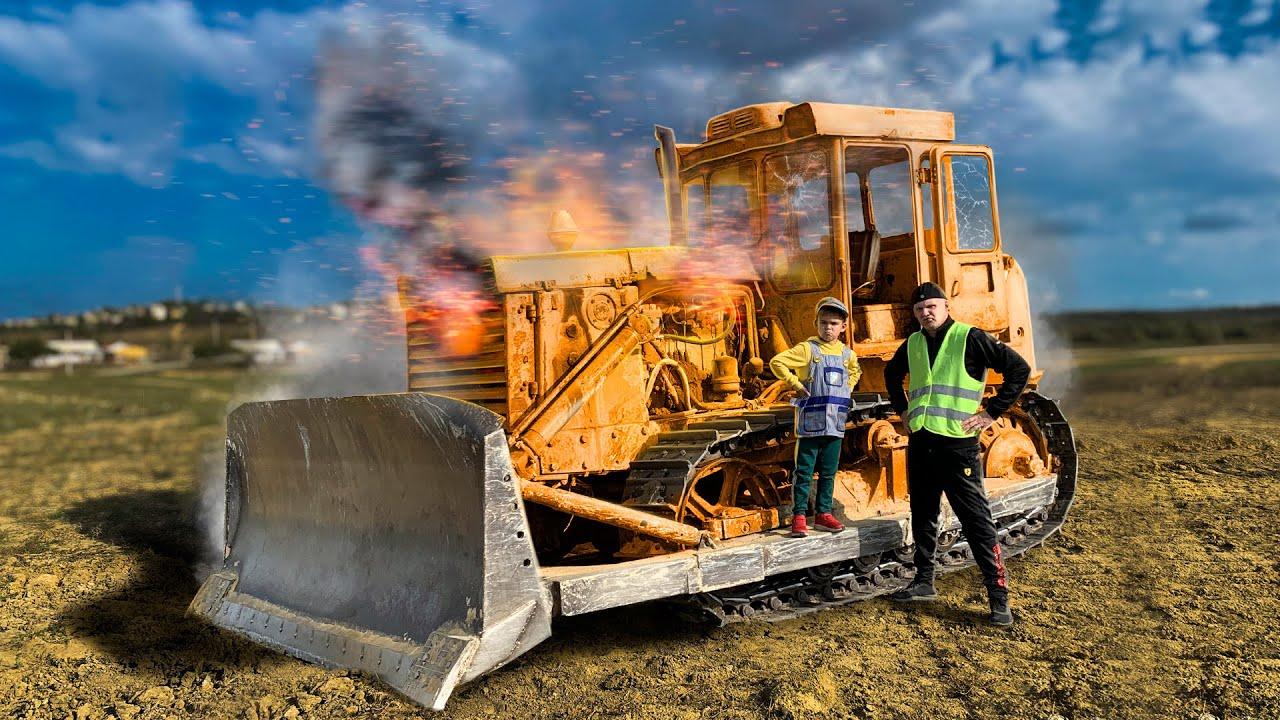 Giant tractor bulldozer is broken down - Dima ride on power wheel bike to help man