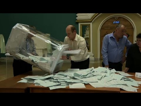 Officials count Russian presidential elections votes