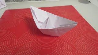 как сделать из бумаги кораблик оригами.(Новый канал ОРИГАМИ МАСТЕР- https://www.youtube.com/channel/UCNsNXYEU62inFHvVMPE6lCg Как сделать классический бумажный кораблик..., 2014-10-10T16:51:56.000Z)