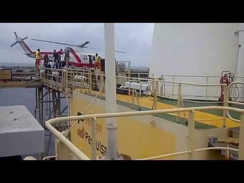 Helicopter landing in Gimboa, Angola ----Binu Alex