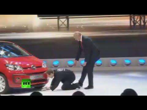 'I have new cheat box!' Protester interrupts Volkswagen presentation in Geneva