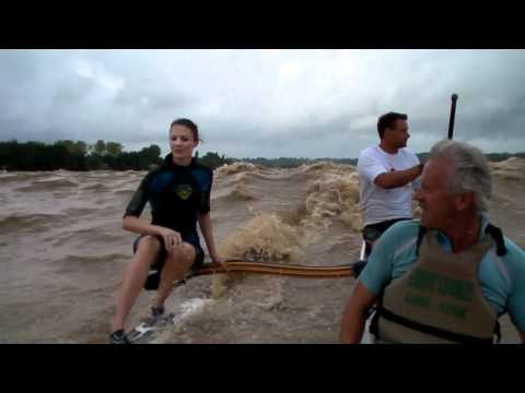 Riding La Gironde river in France - tidal bore surfing