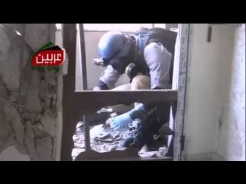 Syria  'UN inspectors collect samples' in protective clothing   video   World news   theguardian com
