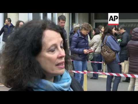 French citizens queue around the block to vote