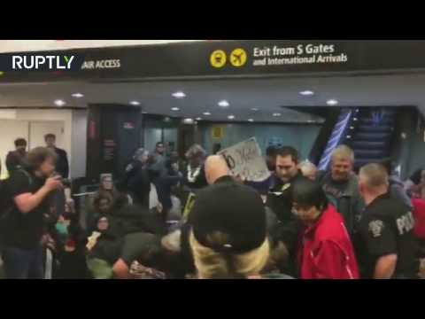 RAW: Police deploy teargas at Seattle airport during rally opposing Trump's 'Muslim ban'