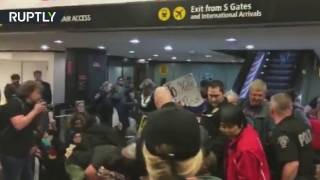 RAW  Police deploy teargas at Seattle airport during rally opposing Trump's 'Muslim ban'