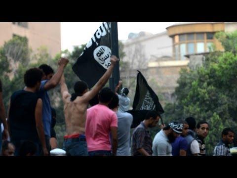 Cairo protesters storm U.S. embassy walls