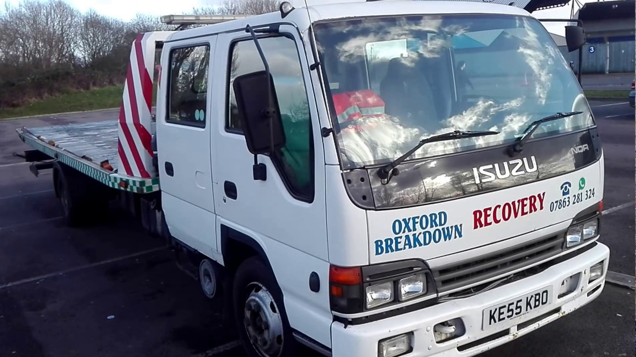 2005 isuzu nqr 70 tilt slide recovery truck with speclift underlift [ 1280 x 720 Pixel ]