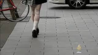 FIRST ROBOT GIRL WALKING IN THE STREET  OF TOKYO - JAPAN