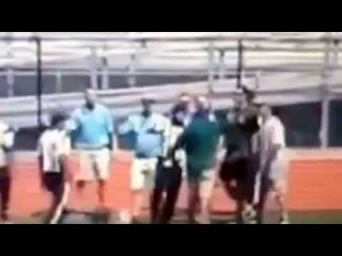 Crazy football fight coach hits kid