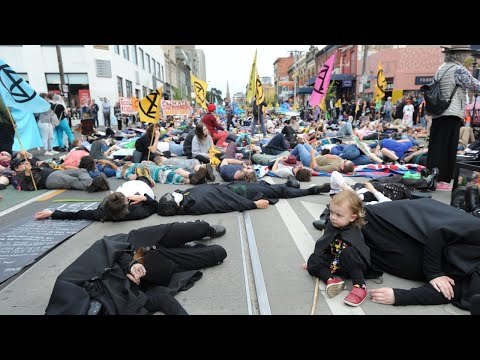 Protest group brings Melbourne to standstill over mining conference