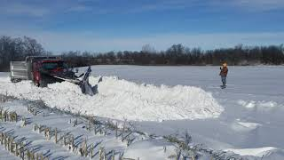County plow opening drifted shut road in Randolph  County, IN