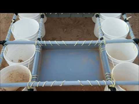 Homemade boat, constructed out of 6 gallon buckets and pvc.