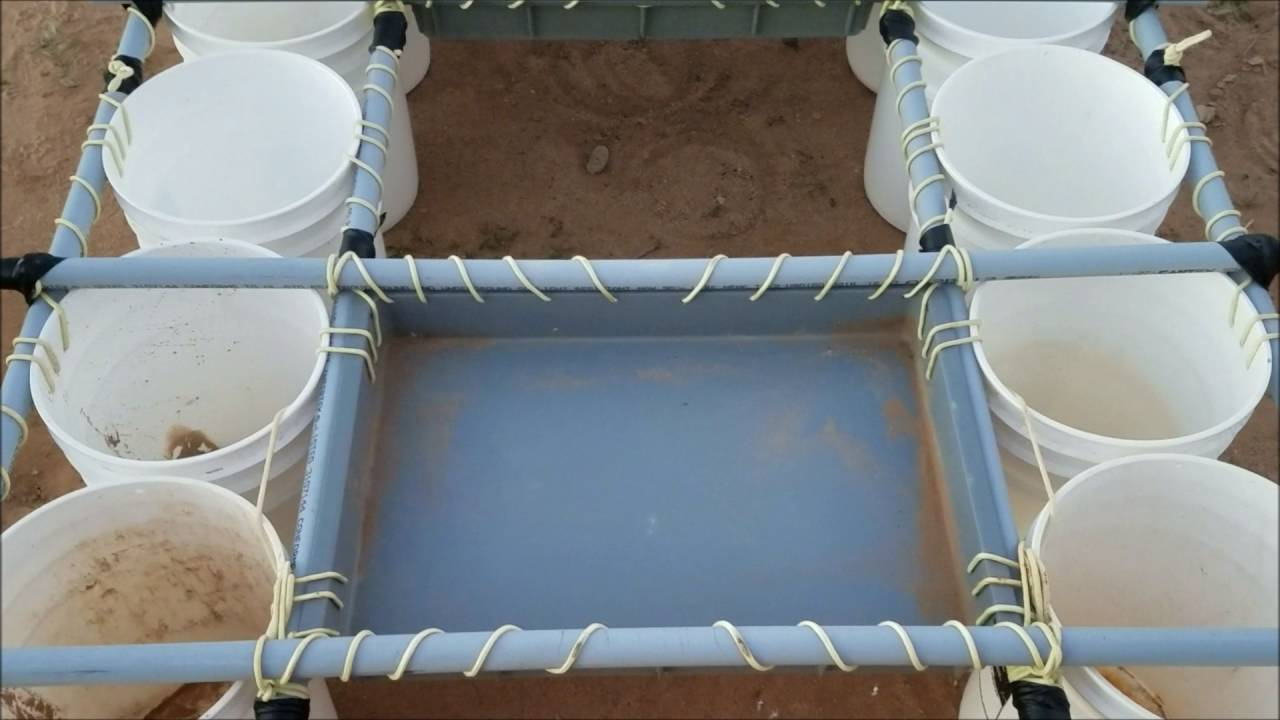 Homemade boat, constructed out of 6 gallon buckets and pvc