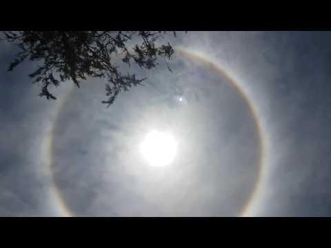 Efecto del sol con aureola al mediodia en Santa Fe